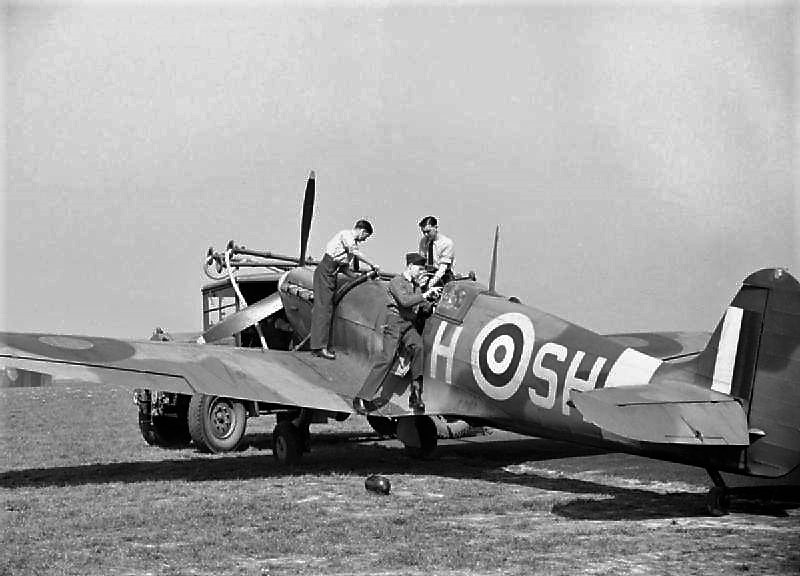 A 64 squadron Spitfire Mk Vb, being refuelled and given the once over by its ground crew.