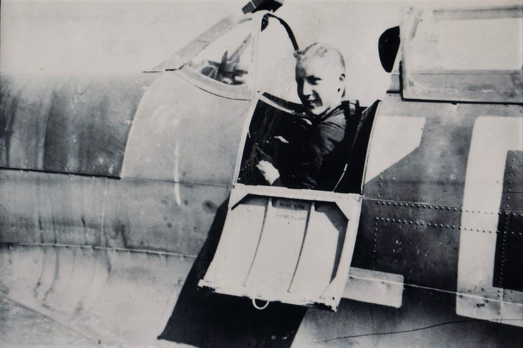Fred Ellis, Flight Rigger of 222 Squadron is seen here sitting in the cockpit of a squadron Spitfire