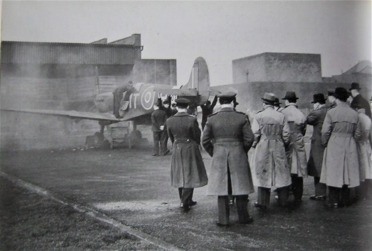 Delegates of the Turkish Production Mission watch a Spitfire undergo firing testing at the aerodrome's firing butts.