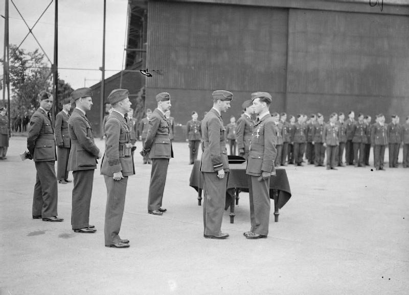 Flying Officer Johnny Allen of 54 Squadron receives the DFC from King George VI at Hornchurch on the 27th June 1940.
