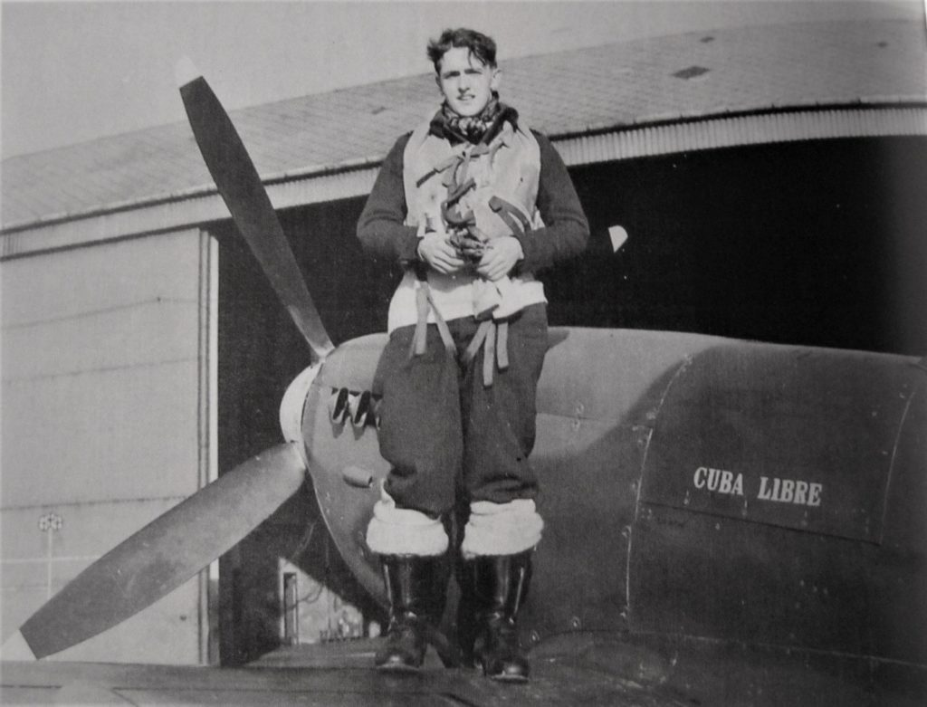 Flying Officer Reginald Frederick Bass of 222 'Natal' squadron poses with his new aircraft 'Cuba Libre'.