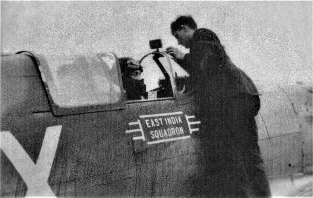 Sergeant Ronnie Stillwell in the cockpit of his 65 'East India' squadron Spitfire Mk I.