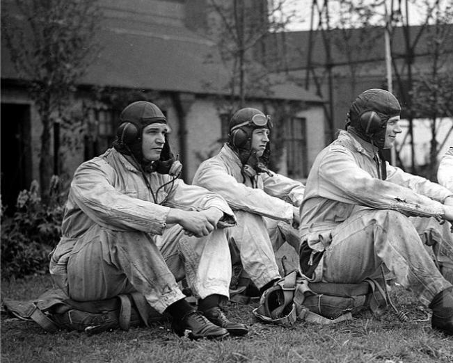 This photograph shows pre-war pilots taking a break outside the main hanger at Hornchurch